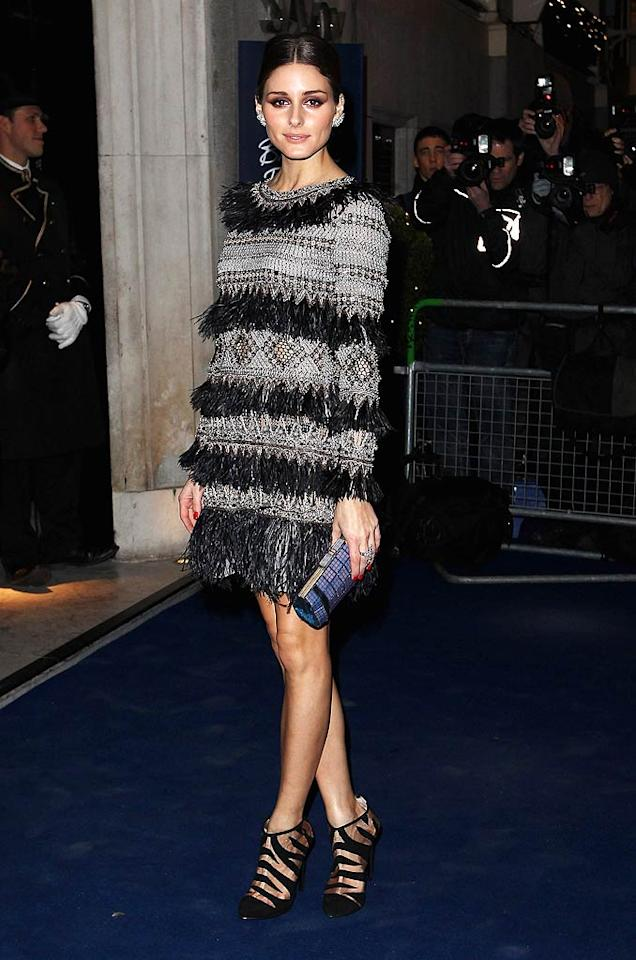 """Olivia Palermo, former star of """"The City,"""" also scored an invite to the stylish soiree. While we don't believe her booties were necessarily the best choice for her ensemble, we adore Olivia's feathery, beaded Matthew Williamson mini. (11/28/2011)"""