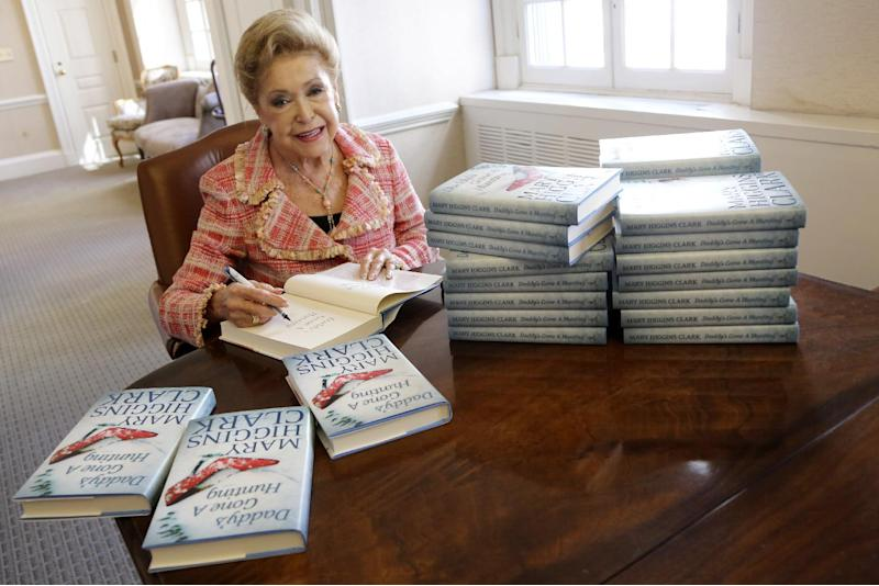 "In this Wednesday, April 3 2013 photo, author Mary Higgins Clark sign copies of her latest book ""Daddy's Gone A Hunting"" at the Simon & Schuster office in New York. Her current book is a vintage Clark thriller featuring women in distress, mysterious pasts and secret identities. It's about a deadly explosion that destroys a family furniture business in Long Island City. (AP Photo/Mary Altaffer)"