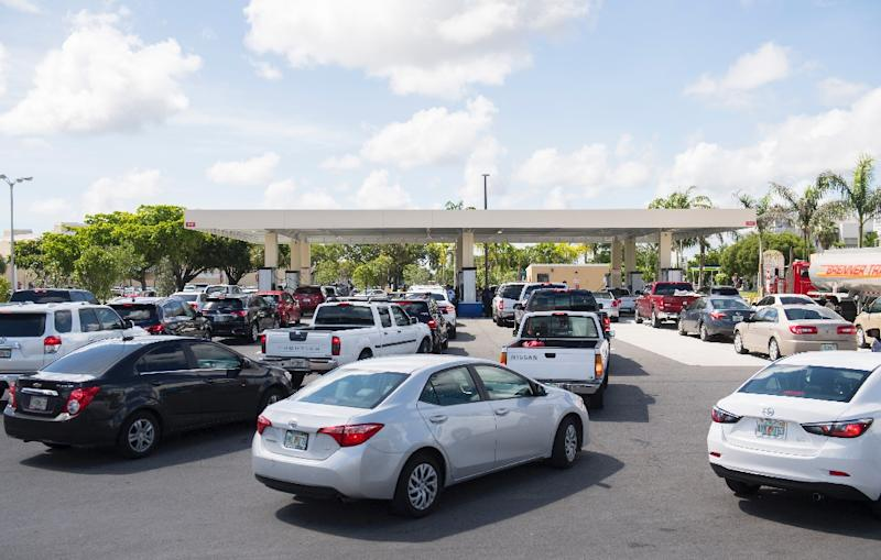 Lines of cars snaked around those gas stations that remained open in Miami, as Florida prepared for Hurricane Irma (AFP Photo/SAUL LOEB)