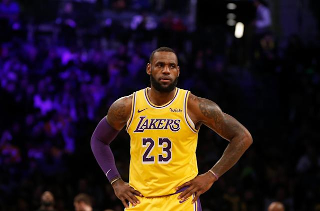 "<a class=""link rapid-noclick-resp"" href=""/nba/players/3704/"" data-ylk=""slk:LeBron James"">LeBron James</a> seems happy he chose basketball for his career. (Getty Images)"