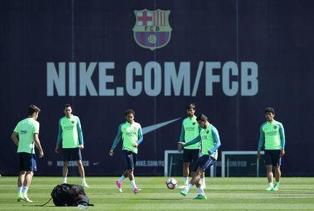 Soccer Football - Barcelona training session - La Liga - Joan Gamper training camp, Barcelona, Spain - 22/4/2017 - Barcelona's players plays with a ball during a training session. REUTERS/Albert Gea
