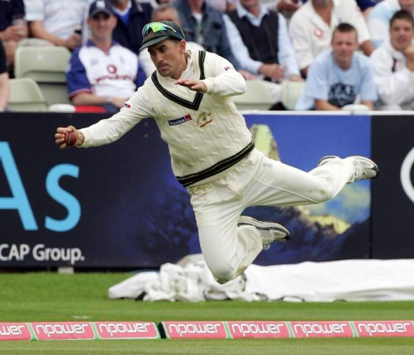 BIRMINGHAM, UNITED KINGDOM - AUGUST 4: Justin Langer of Australia dives to prevent a ball going for for four during day one of the Second npower Ashes Test between England and Australia played at Edgbaston on August 4, 2005 in Birmingham, United Kingdom (Photo by Hamish Blair/Getty Images)