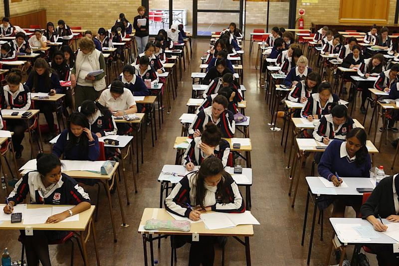 Pictured: Students sit HSC exam to receive results and ATAR. (Photo by Steve Christo/Sydney Morning Herald/Fairfax Media via Getty Images via Getty Images)