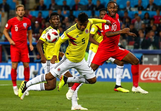 <p>Colombia's Jefferson Lerma, Wilmar Barrios, and England's Raheem Sterling (L-R) fight for the ball in their 2018 FIFA World Cup Round of 16 match at Spartak Stadium. Mikhail Tereshchenko/TASS (Photo by Mikhail Tereshchenko\TASS via Getty Images) </p>