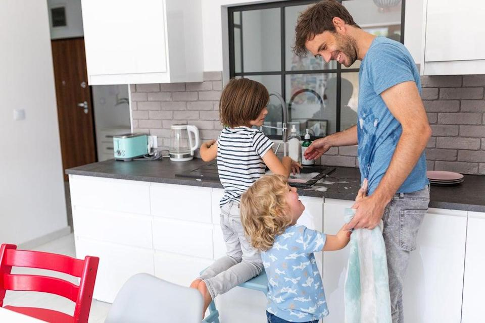 Children and father in kitchen (Alamy/PA)