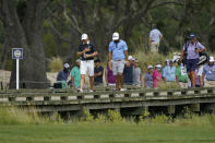 Jordan Spieth, left, walks along with Max Homa, center, during a practice round at the PGA Championship golf tournament on the Ocean Course Wednesday, May 19, 2021, in Kiawah Island, S.C. (AP Photo/Matt York)