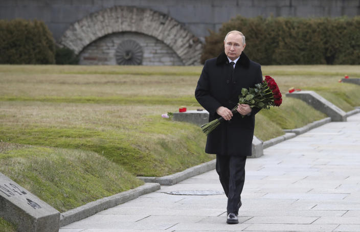 President Vladimir Putin attends a wreath laying commemoration ceremony for the 77th anniversary since the Leningrad siege was lifted during the World War Two at the Piskaryovskoye Memorial Cemetery, where hundreds of thousands of siege victims are buried, in St.Petersburg, Russia, Saturday, Jan. 18, 2020. (Alexei Danichev, Sputnik, Kremlin Pool Photo via AP)