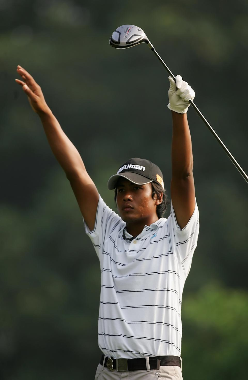 FANLING, HONG KONG - NOVEMBER 18:  Juvic Pagunsan of The Philippines gestures on the 13th hole during the third round of the UBS Hong Kong Open at the Hong Kong Golf Club on November 18, 2006 in Fanling, Hong Kong.  (Photo by Stuart Franklin/Getty Images)