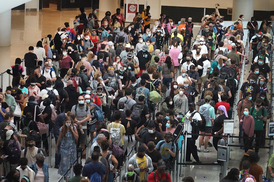 People stand in line to get through the security checkpoint at Louis Armstrong New Orleans International Airport (Getty Images)