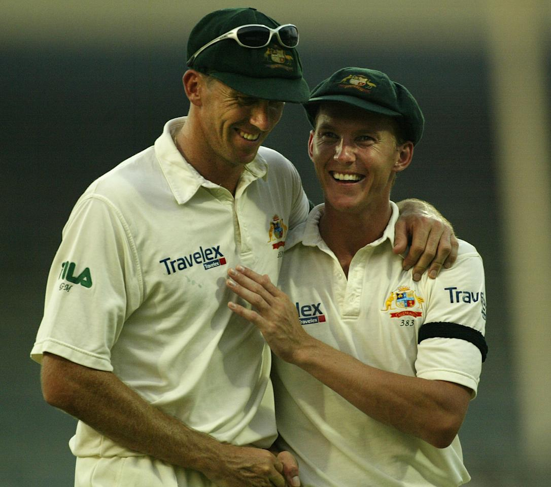 SHARJAH - OCTOBER 21:  Glenn McGrath and Brett Lee of Australia share a joke as the players leave the field due too bad light during day three of the Third Test between Pakistan and Australia played at Sharjah International Cricket Stadium in Sharjah, United Arab Emirates on October 21, 2002. (Photo by Hamish Blair/Getty Images)