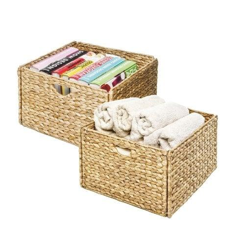 "<p>These open <a href=""https://www.popsugar.com/buy/Seville-Classics-Foldable-Handwoven-Water-Hyacinth-Cube-Storage-Baskets-2-Pack-522784?p_name=Seville%20Classics%20Foldable%20Handwoven%20Water%20Hyacinth%20Cube%20Storage%20Baskets%20%282-Pack%29&retailer=amazon.com&pid=522784&price=25&evar1=casa%3Aus&evar9=46938975&evar98=https%3A%2F%2Fwww.popsugar.com%2Fphoto-gallery%2F46938975%2Fimage%2F46938976%2FSeville-Classics-Foldable-Handwoven-Water-Hyacinth-Cube-Storage-Basket-2-Pack&list1=amazon%2Corganizing%2Cstorage%2Chome%20shopping&prop13=api&pdata=1"" rel=""nofollow"" data-shoppable-link=""1"" target=""_blank"" style=""background-color: rgb(255, 255, 255);"" class=""ga-track"" data-ga-category=""Related"" data-ga-label=""https://www.amazon.com/Seville-Classics-Foldable-Handwoven-Hyacinth/dp/B00C78TRG6/ref=sr_1_22?crid=17X7BZIGH2RUV&amp;keywords=baskets+for+organizing&amp;qid=1574473449&amp;s=home-garden&amp;sprefix=basket%2Cgarden%2C143&amp;sr=1-22"" data-ga-action=""In-Line Links"">Seville Classics Foldable Handwoven Water Hyacinth Cube Storage Baskets (2-Pack)</a> ($25) are infinitely useful when used as drawers for bookshelves or for keeping linens organized. </p>"