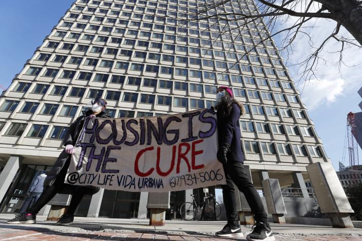 FILE - In this Jan. 13, 2021, file photo tenants' rights advocates demonstrate outside the JFK federal building in Boston. The protest was part of a national day of action calling on the incoming Biden administration to extend the eviction moratorium initiated in response to the Covid-19 pandemic. A federal judge ruled ruled Wednesday, May 5, that the Centers for Disease Control and Prevention exceeded its authority when it imposed a federal eviction moratorium. (AP Photo/Michael Dwyer, File)