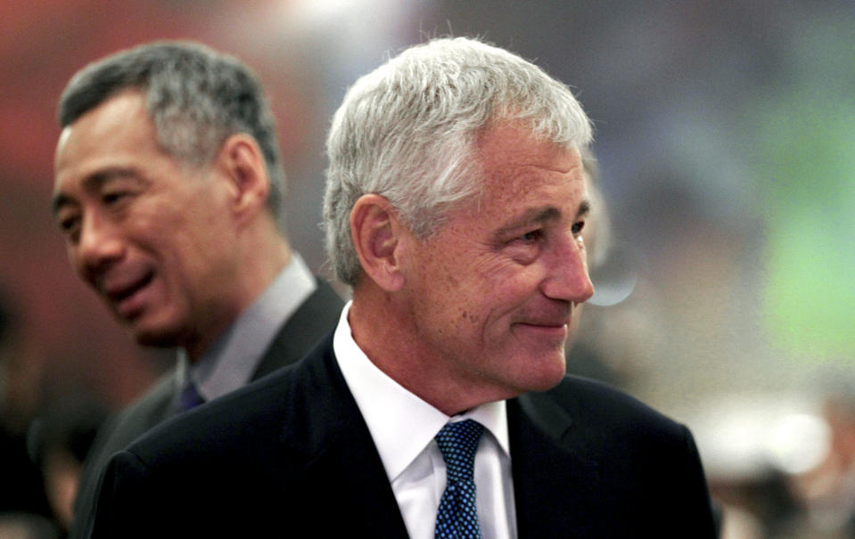 U.S. Defense Secretary Chuck Hagel, left, and Singapore's Prime Minister Lee Hsien Loong, left, attend the opening of the International Institute for Strategic Studies Shangri-la Dialogue, or IISS Asia Security Summit in Singapore, Friday, May 31, 2013. (AP Photo/Wong Maye-E)