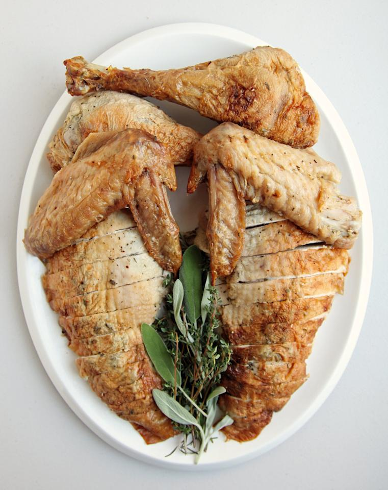 """<p><b>Get the recipe:</b> <a href=""""http://thepioneerwoman.com/cooking/roasted_thanksgiving_turkey/"""" target=""""_blank"""" class=""""ga-track"""" data-ga-category=""""Related"""" data-ga-label=""""http://thepioneerwoman.com/cooking/roasted_thanksgiving_turkey/"""" data-ga-action=""""In-Line Links"""">roasted rosemary turkey</a></p>"""