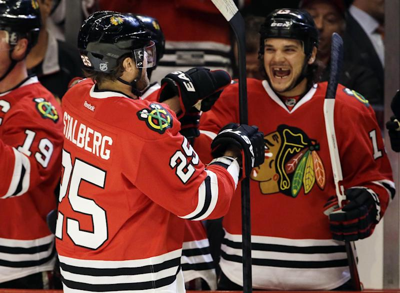 Chicago Blackhawks' Viktor Stalberg (25) celebrates with teammates after scoring his goal during the first period of an NHL hockey game against the Columbus Blue Jackets in Chicago, Friday, March 1, 2013. (AP Photo/Nam Y. Huh)