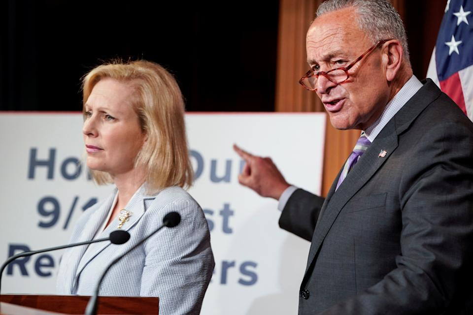 U.S. Senators Kirsten Gillibrand (D-NY) and Senate Minority Leader Chuck Schumer (D-NY) during media briefing on Capitol Hill in Washington in 2019.  (Joshua Roberts/Reuters)