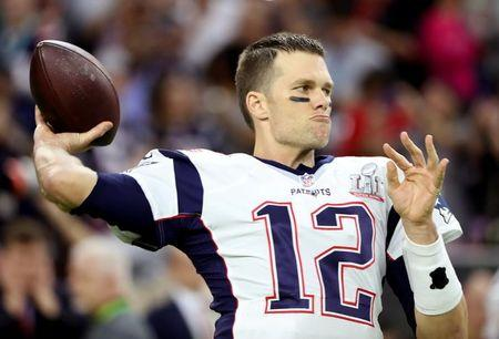 FILE PHOTO: New England Patriots' quarterback Tom Brady warms up before Super Bowl LI against the Atlanta Falcons in Houston