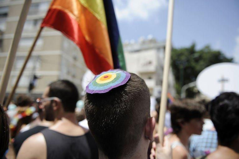 A man wears a kippah with rainbow colors during the Gay Parade in the coastal Israeli city of Tel Aviv on June 7, 2013