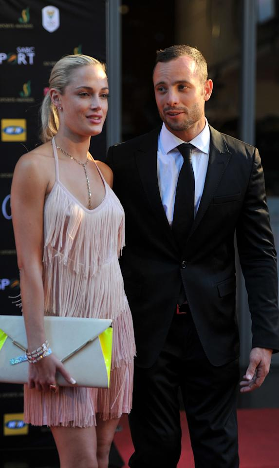 <p>Oscar Pistorius pictured here with girlfriedn Reeva Steenkamp at the Feather Awards on November 4, 2012 in Johannesburg, South Africa. (Photo by Lucky Nxumalo/City Press/Gallo Images/Getty Images)</p>
