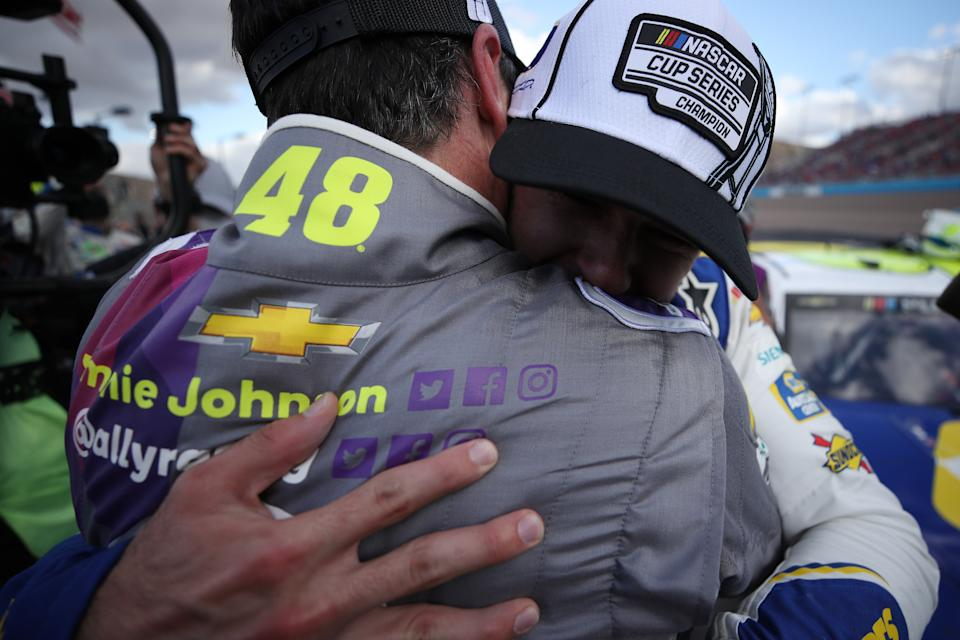 <em>Chase Elliott and Jimmie Johnson share a hug after Sunday's race at Phoenix (Chris Graythen/Getty Images).</em>