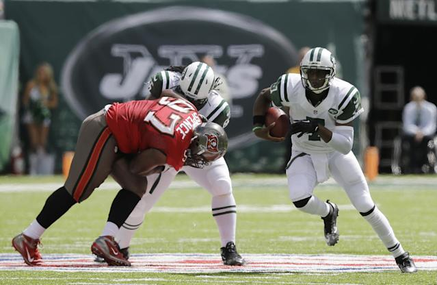 New York Jets quarterback Geno Smith (7) runs with the ball in the first half of an NFL football game against the Tampa Bay Buccaneers, Sunday, Sept. 8, 2013, in East Rutherford, N.J. (AP Photo/Mel Evans)
