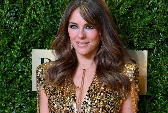 Elizabeth Hurley has stunned fans in by wearing a Versace gown she first wore 21 years ago, pictured here in New York November 2019. (Getty Images)