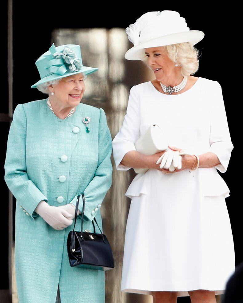 <p>Matching in monochrome: Queen Elizabeth and her daughter-in-law Camilla, Duchess of Cornwall both chose to go monochrome (blue in the Queen's case, white for Camilla) to meet with Donald Trump at the Buckingham Palace garden in 2019. </p>