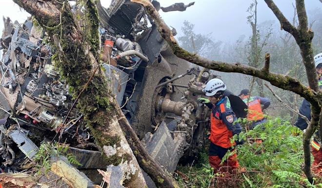 A rescue team searches the helicopter's wreckage. Photo: Reuters