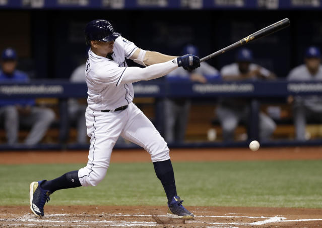 Tampa Bay Rays' Willy Adames hits an RBI single off Kansas City Royals relief pitcher Jorge Lopez during the second inning of a baseball game Monday, Aug. 20, 2018, in St. Petersburg, Fla. Rays' Joey Wendle scored. (AP Photo/Chris O'Meara)