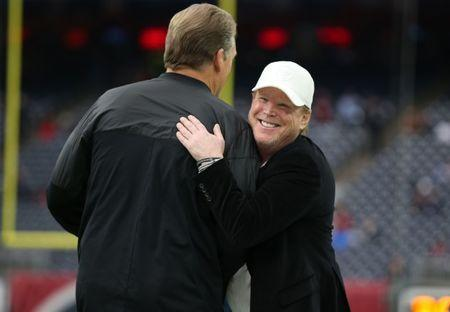 FILE PHOTO: Oakland Raiders owner Mark Davis smiles as he hugs coach Jack Del Rio prior to the game against the Houston Texans in the AFC Wild Card playoff football game at NRG Stadium. Mandatory Credit: Matthew Emmons-USA TODAY Sports