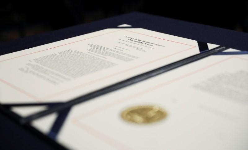 House articles of impeachment of President Trump await U.S. House Speaker Pelosi's signature before engrossment ceremony at the U.S. Capitol in Washington