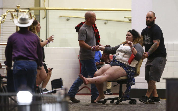 <p>A wounded woman is moved outside the Tropicana during an active shooter situation on the Las Vegas Strip in Las Vegas Sunday, Oct. 1, 2017. (Photo: Chase Stevens/Las Vegas Review-Journal via AP) </p>