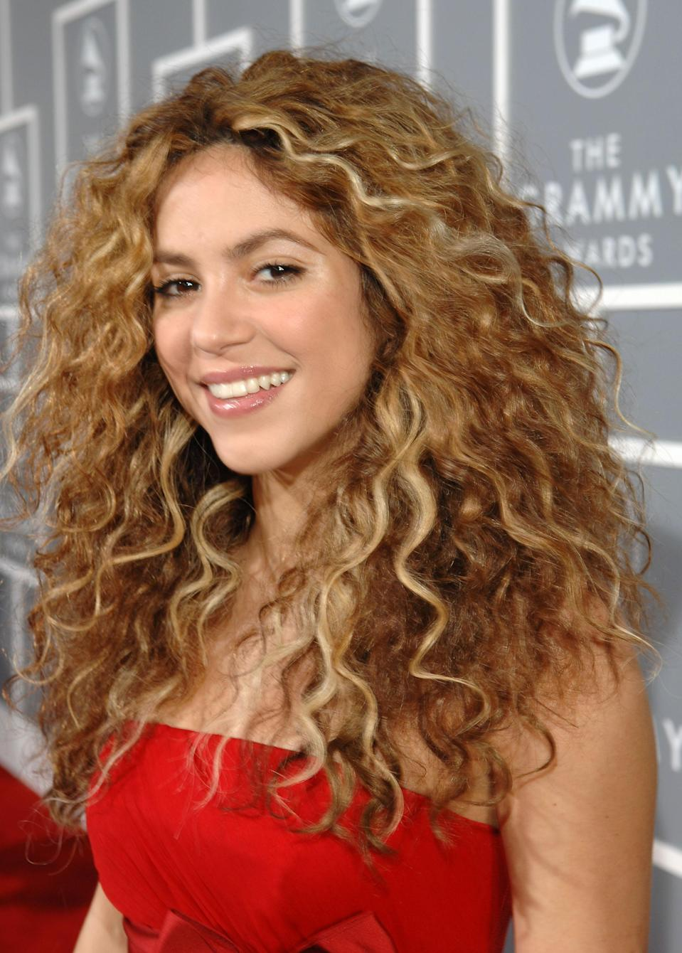 "<p>You may not remember when <a href=""https://www.yahoo.com/lifestyle/tagged/shakira"" data-ylk=""slk:Shakira"" class=""link rapid-noclick-resp"">Shakira</a> first stepped on the world's stage with vibrant raspberry strands, but when the Colombian rocker crossed over into the states, she made the dramatic switch to the blonde we know and love today. Hair color aside, the hip-shimmying songstress is known for embracing her <a href=""https://www.yahoo.com/lifestyle/tagged/curly-hair"" data-ylk=""slk:curls"" class=""link rapid-noclick-resp"">curls</a>, whether she's on the red carpet or performing onstage. And if you have natural curls like hers, it's all about having <a href=""https://www.yahoo.com/lifestyle/shakira-reveals-her-secret-her-150717636.html"" data-ylk=""slk:the right products;outcm:mb_qualified_link;_E:mb_qualified_link;ct:story;"" class=""link rapid-noclick-resp yahoo-link"">the right products</a>. (Photo: Getty Images) </p>"
