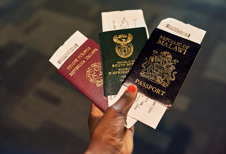 Shot of an unrecognizable person holding passports indoors