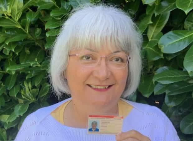 Vivian Hermanson holds her expired Certificate of Indian Status. She applied for a secure card on Mar. 3 and launched her petition 22 days later. (Vivian Hermanson - image credit)