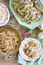 """<p>An array of hearty dishes displayed in festive hodgepodge servingware makes this Tex-Mex meal perfect for Christmas at the ranch.</p><p><strong>Main Course:</strong></p><p><a href=""""https://www.countryliving.com/food-drinks/recipes/a45490/beer-braised-chicken-recipe/"""" rel=""""nofollow noopener"""" target=""""_blank"""" data-ylk=""""slk:Beer-Braised Chicken"""" class=""""link rapid-noclick-resp"""">Beer-Braised Chicken</a><span class=""""redactor-invisible-space""""> and <a href=""""https://www.countryliving.com/food-drinks/recipes/a45489/jalapeno-ranch-coleslaw-recipe/"""" rel=""""nofollow noopener"""" target=""""_blank"""" data-ylk=""""slk:Jalapeno Ranch Coleslaw"""" class=""""link rapid-noclick-resp"""">Jalapeno Ranch Coleslaw</a><span class=""""redactor-invisible-space""""><a href=""""https://www.countryliving.com/food-drinks/recipes/a45489/jalapeno-ranch-coleslaw-recipe/"""" rel=""""nofollow noopener"""" target=""""_blank"""" data-ylk=""""slk:Tacos"""" class=""""link rapid-noclick-resp""""> Tacos</a></span></span><a href=""""https://www.countryliving.com/food-drinks/recipes/a45489/jalapeno-ranch-coleslaw-recipe/"""" rel=""""nofollow noopener"""" target=""""_blank"""" data-ylk=""""slk:"""" class=""""link rapid-noclick-resp""""><br></a></p><p><strong>Side Dishes:</strong> </p><p><a href=""""https://www.countryliving.com/food-drinks/recipes/a45486/buttermilk-and-hatch-chile-grits-recipe/"""" rel=""""nofollow noopener"""" target=""""_blank"""" data-ylk=""""slk:Buttermilk and Hatch Chile Grits"""" class=""""link rapid-noclick-resp"""">Buttermilk and Hatch Chile Grits<br></a> </p><p><span class=""""redactor-invisible-space""""><a href=""""https://www.countryliving.com/food-drinks/recipes/a45487/oven-avocado-fries-recipe/"""" rel=""""nofollow noopener"""" target=""""_blank"""" data-ylk=""""slk:Oven Avocado Fries"""" class=""""link rapid-noclick-resp"""">Oven Avocado Fries</a> </span></p><p><span class=""""redactor-invisible-space""""><span class=""""redactor-invisible-space""""><a href=""""https://www.countryliving.com/food-drinks/recipes/a45488/black-pepper-and-bacon-pinto-beans-recipe/"""" rel=""""nofollow noopener"""" target=""""_blank"""" data-ylk=""""slk:Black Pepper and Bacon Pinto"""