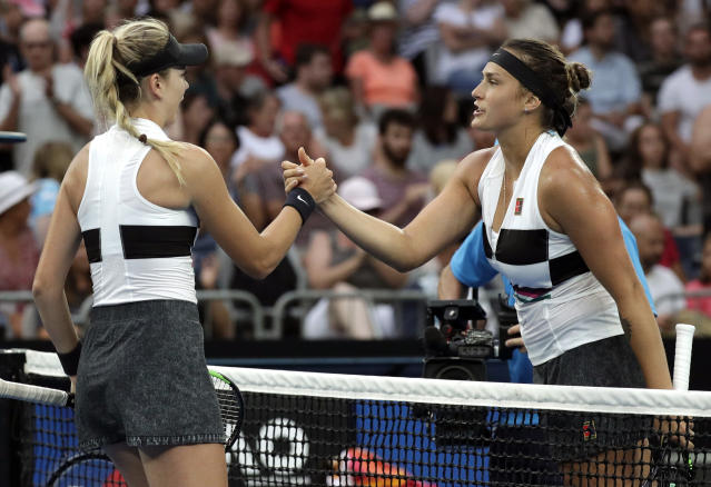 Aryna Sabalenka, right, of Belarus is congratulated by Britain's Katie Boulter after winning their second round match at the Australian Open tennis championships in Melbourne, Australia, Wednesday, Jan. 16, 2019. (AP Photo/Kin Cheung)