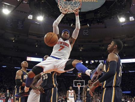 New York Knicks forward Anthony slam dunks in front of Indiana Pacers forward George in second half NBA game in New York