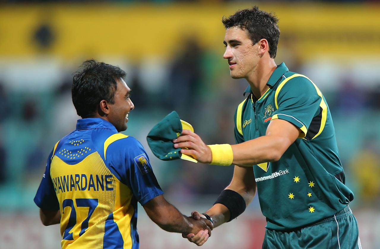 SYDNEY, AUSTRALIA - JANUARY 20:  Mitchell Starc of Australia shakes hands with Mahela Jayawardena of Sri Lanka after play was abandoned due to rain following game four of the Commonwealth Bank one day international series between Australia and Sri Lanka at Sydney Cricket Ground on January 20, 2013 in Sydney, Australia.  (Photo by Brendon Thorne/Getty Images)