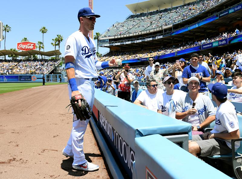 LOS ANGELES, CALIFORNIA - JUNE 23: Cody Bellinger #35 of the Los Angeles Dodgers looks to give a ball to the fan he accidentally hit with a foul ball while at bat during the first inning against the Colorado Rockies at Dodger Stadium on June 23, 2019 in Los Angeles, California. (Photo by Harry How/Getty Images)