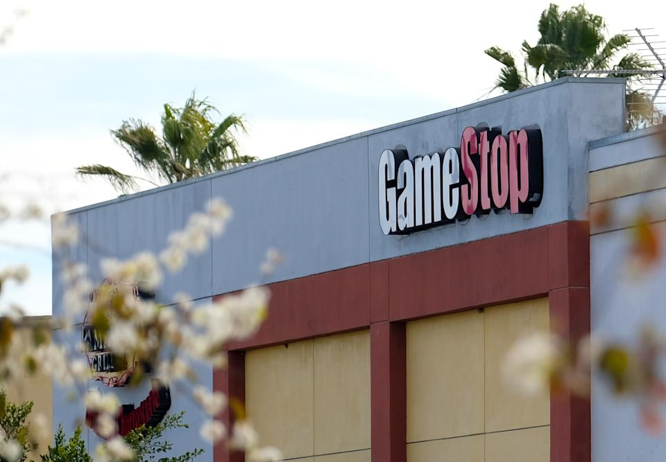 The GameStop logo sign is seen above the store in Culver City, California on January 28, 2021. - An epic battle is unfolding on Wall Street, with a cast of characters clashing over the fate of GameStop, a struggling chain of video game retail stores. The conflict has sent GameStop on a stomach-churning ride with amateur investors taking on the financial establishment in the mindset of the Occupy Wall Street movement launched a decade ago. (Photo by Chris DELMAS / AFP) (Photo by CHRIS DELMAS/AFP via Getty Images)