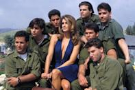 <p>Posing with Israeli soldiers in 1992.</p>