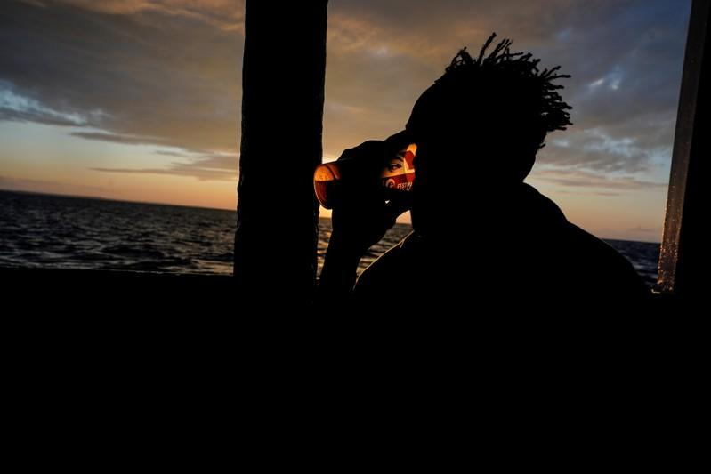 Migrant drinks a tea on board of NGO Proactiva Open Arms rescue boat in the central Mediterranean Sea at the Italian port of Taranto