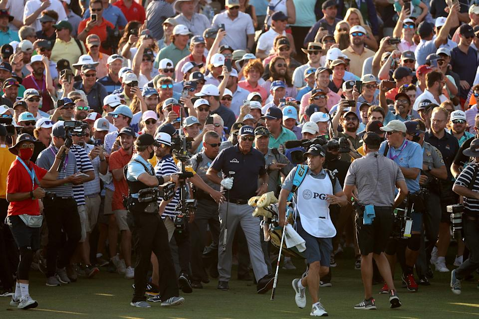 Phil Mickelson (pictured) was swamped by the crowd just before and after his 2021 PGA Championship triumph.