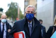 FILE PHOTO: European Union's Brexit negotiator Michel Barnier walks at Westminster in London