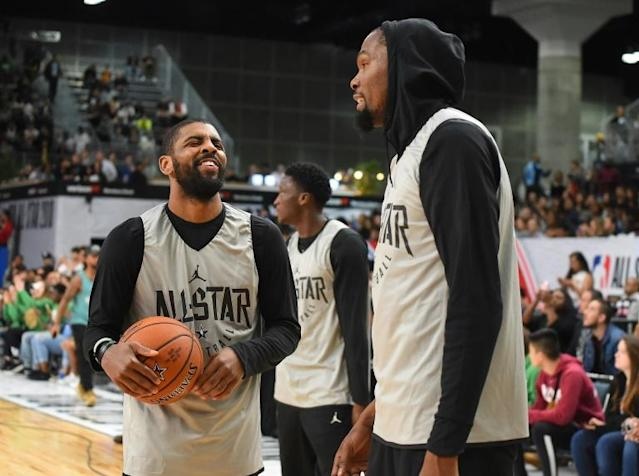 Kyrie Irving, left, and Kevin Durant of the Brooklyn Nets could have a new NBA boss as reports have Alibaba Group co-founder Joseph Tsai buying complete control of the team (AFP Photo/Jayne Kamin-Oncea)