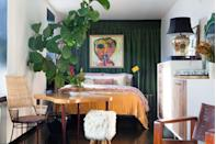 <p>In this eclectic apartment, Kelly Framel uses a deep green curtain to give a moodier backdrop for colorful art and furniture. </p>