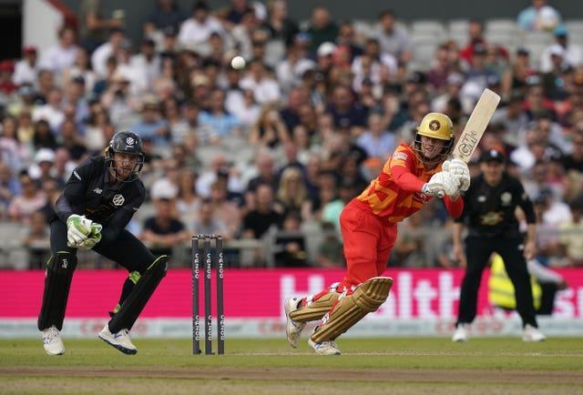 Birmingham Phoenix's Miles Hammond (right) and Manchester Originals' Jos Buttler in action during The Hundred match at Old Trafford