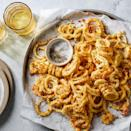 """<p>Curly fries get a makeover by using summer squash in place of potatoes. Summer squash """"noodles"""" are tossed in a panko mixture spiked with lemon, garlic powder and Parmesan cheese and baked until crispy. If you can't find summer squash noodles, make your own using a spiralizer or vegetable peeler.</p>"""