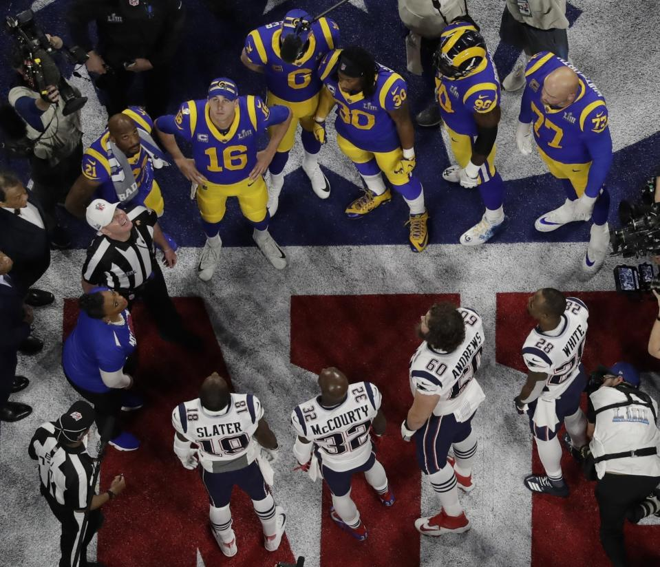 Referee John Parry and players watch the coin toss before Super Bowl LIII. (AP Photo/Morry Gash)